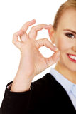Young happy business woman shows OK sign Stock Photo