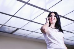 Young happy business woman talking by cellphone Stock Photos