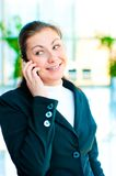 Young happy business woman talking on the phone Stock Image