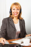 Young happy business woman work in office. Young business woman work in office Royalty Free Stock Image