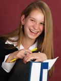 Young happy business woman. Young business woman with folders and pencil Stock Photography