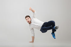 Young happy businessman with beard in shirt break dancing on gre Royalty Free Stock Photo