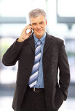 Young happy businessman calling Stock Images