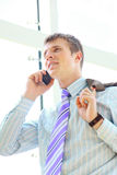 Young happy businessman calling on mobile phone Royalty Free Stock Photos