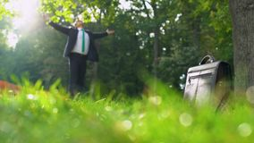 Young happy businessman enjoying life, inspired by nature in beautiful forest stock footage
