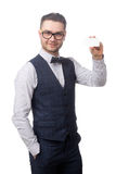 Young happy businessman holding a card in the hand isolated on white Stock Images