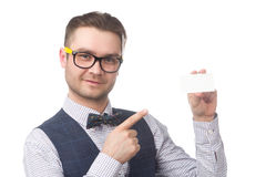 Young happy businessman holding a card in the hand isolated on white Royalty Free Stock Photo