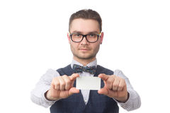 Young happy businessman holding a card in the hands isolated on white Royalty Free Stock Photo