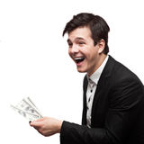 Young happy businessman holding money Royalty Free Stock Photography