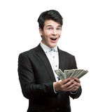 Young happy businessman holding money Royalty Free Stock Image