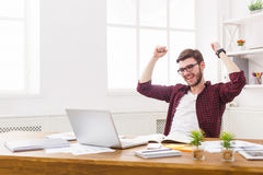 Young happy businessman in office with computer Royalty Free Stock Images