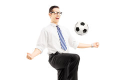 Young happy businessman playing with a soccer ball Royalty Free Stock Photography
