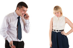 Young happy businessman and sad wife Stock Photo