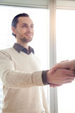 Young happy businessman shaking female hand, recruitment and hir Royalty Free Stock Images