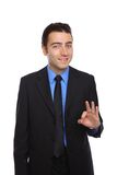 Young happy businessman showing ok Stock Photo
