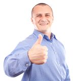 Young happy businessman showing thumbs up sign. Portrait of a young happy businessman showing thumbs up sign, isolated on white background Royalty Free Stock Photos