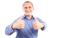 Young happy businessman showing thumbs up sign Stock Photo