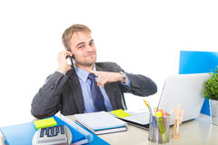 Young happy businessman smiling confident talking on mobile phone at office computer desk Stock Photos