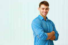 Young happy businessman standing with arms folded Stock Image