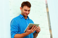 Young happy businessman standing with tablet computer near Royalty Free Stock Photography