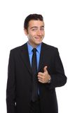 Young happy businessman with thumb up Stock Images