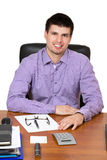 Young happy businessman working on his desk royalty free stock photos