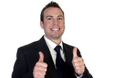 Young happy businesssman and showing thumbsup Royalty Free Stock Image