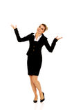 Young happy businesswoman with arms up. Winning concept Royalty Free Stock Photo
