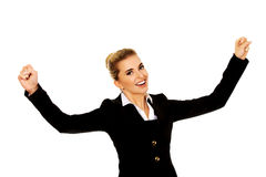 Young happy businesswoman with arms up. Winning concept Stock Photo