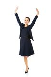 Young happy businesswoman with hands up Royalty Free Stock Photo