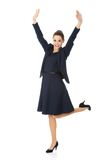 Young happy businesswoman with hands up Stock Image