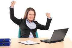 A young happy businesswoman in her office Royalty Free Stock Photos