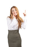 Young happy businesswoman pointing up Royalty Free Stock Image