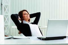 Young happy businesswoman resting Stock Photos