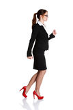 Young happy businesswoman in a rush. Royalty Free Stock Images