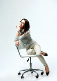 Young happy businesswoman sitting on the office chair Royalty Free Stock Photography