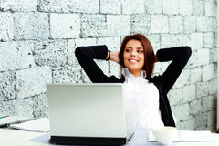 Young happy businesswoman sitting at the table Royalty Free Stock Images