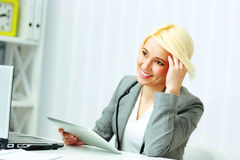 Young happy businesswoman with tablet computer looking at copyspace Stock Images