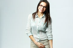 Young happy businesswoman wearing glasses standing Stock Photo