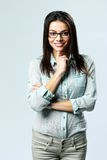 Young happy businesswoman wearing glasses standing Stock Photography