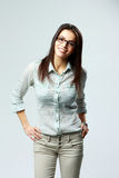 Young happy businesswoman wearing glasses standing Royalty Free Stock Images