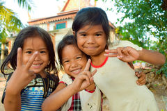 Young, happy Cambodian girls outside the community buildings. The young girls belonged to the floating village community near Siem Reap, Cambodia.  The community Stock Photo