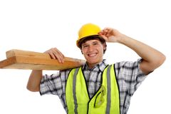 Young Happy Carpenter Holding Building Materials Royalty Free Stock Image