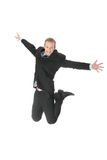 Young happy caucasian businessman jumping Stock Photo