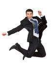 Young happy caucasian businessman jumping in the air Stock Photo