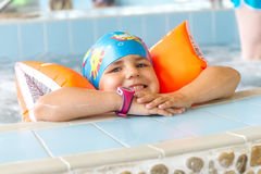 Young happy caucasian child girl swimming Stock Photo