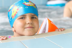 Young happy caucasian child girl swimming Royalty Free Stock Photo