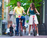 Young happy caucasian couple on bikes in old Stock Photography