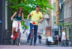 Young happy caucasian couple on bikes in old Stock Photos