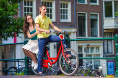 Young happy caucasian couple on bikes in old Royalty Free Stock Images